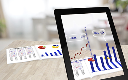 Augmented reality business magazine seen through a tablet with enhanced charts