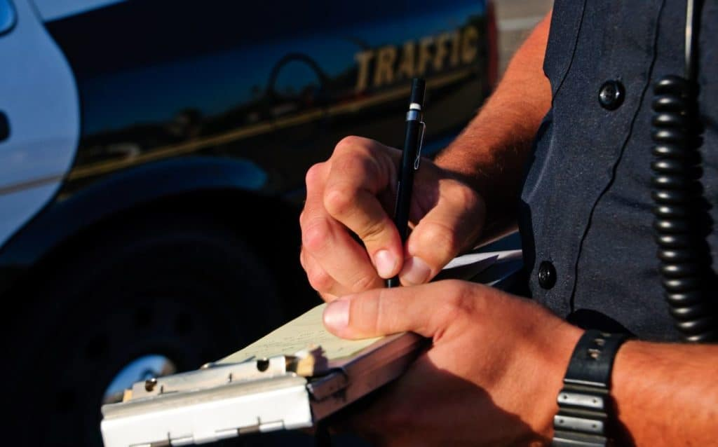 writing a traffic citation vs ticket