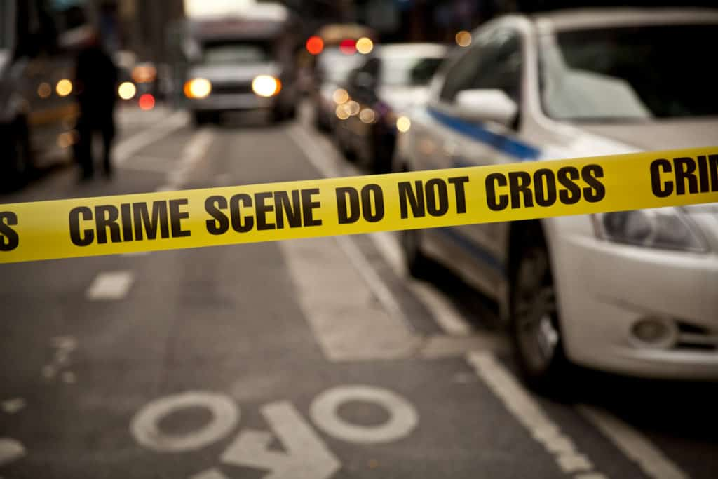 What is the first step in analyzing a crime scene? Police tape image